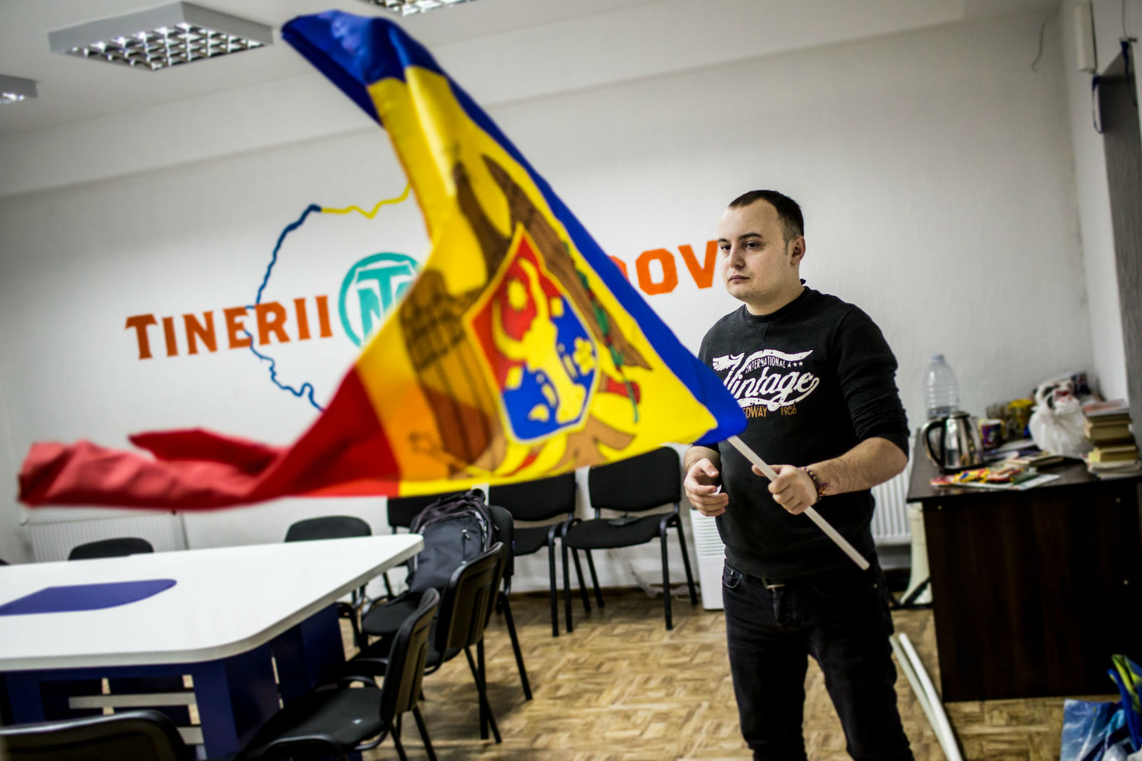 A member of Youth of Moldova waves the national flag