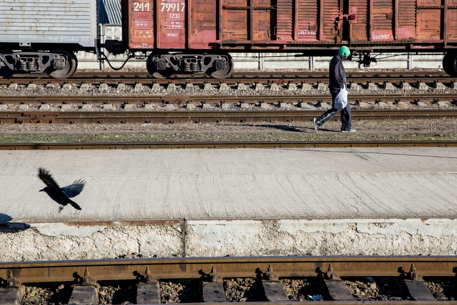 A man walks by the central railway station in Chișinău