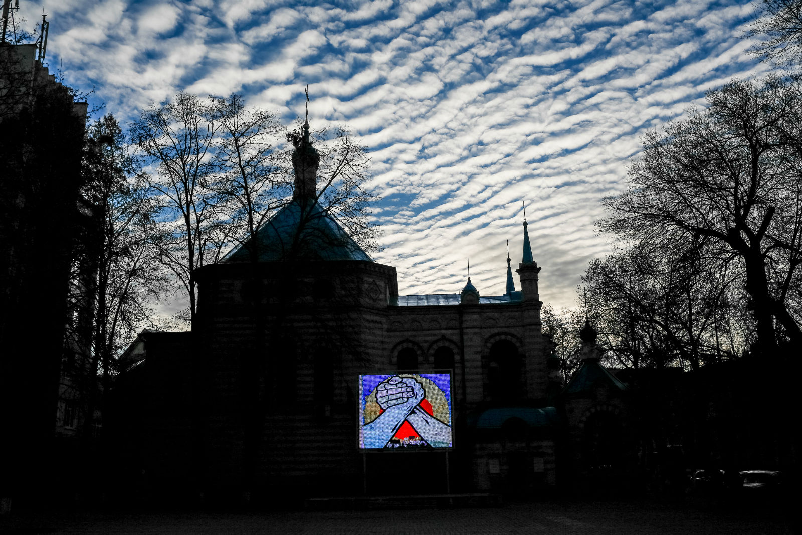 The symbol of Moldovan and Romanian unity displayed on a screen in the centre of Chișinău.