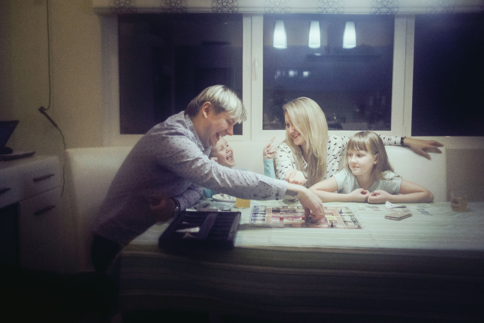 Rene and Bronislava playing with their children at home. Narva, Estonia.